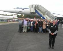 Brooklands Motor and Aero Museum in Surrey - Donna Hopton of Brooklands with a group of tour buyers from around the UK